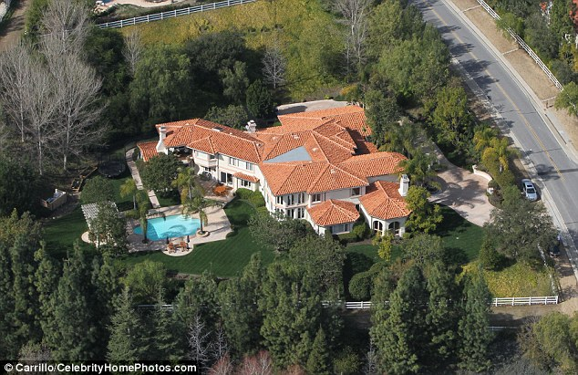 Scene of the confusion: A 15 strong SWAT team and helicopters rushed to the Jenner home in Calabasas, California after a bogus report of a shooting