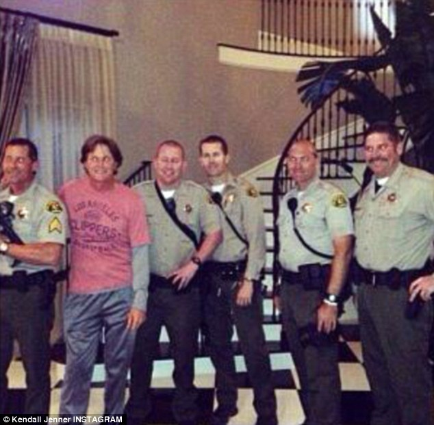 Never miss a photo opportunity, Kardashian 101: Bruce Jenner posed merrily with the police offers who were called to his house to investigate a bogus shooting on Friday
