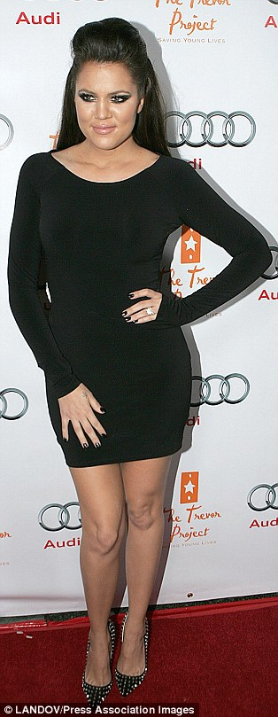 Happy being heavier: Khloe Kardashian (December 2012 left, June 2009 right) has stopped trying to change her body image