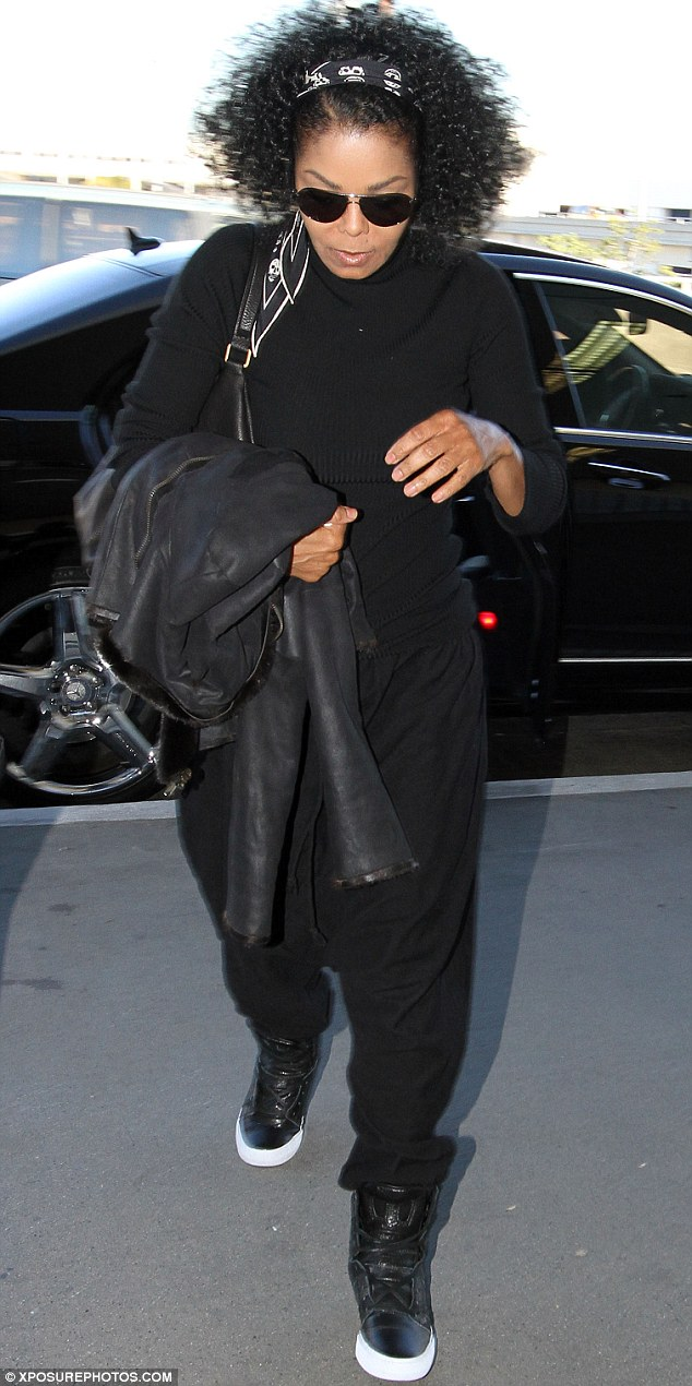 U Can't Touch This! Janet Jackson dressed comfortably for her flight from Los Angeles on Saturday in a pair of MC Hammer-style trousers