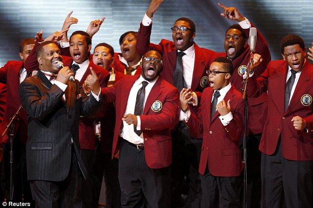 Sing out loud: Soul Children of Chicago choir perform during the Kids Inaugural concert for children and military families