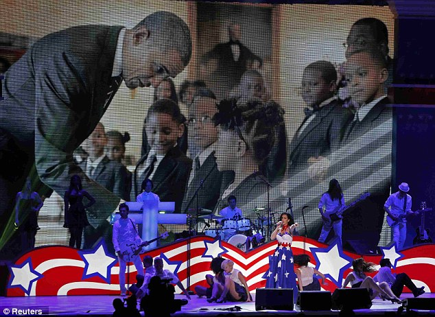 Patriotic: Katy Perry performs as a picture of U.S. President Obama is shown in the background