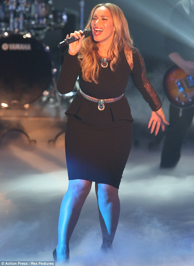 Killer curves: Leona Lewis showed off her fuller figure as she performed in Germany in Saturday evening
