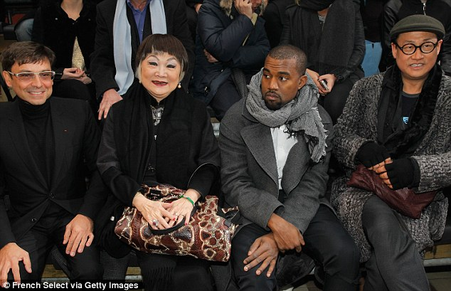 Happy to be there? Kanye sat in the front row with Lanvin's owner, Shaw Lan Wang and other guests