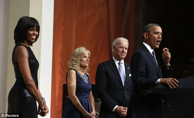 First couples: Obama speaks to his supporters on Sunday night as wife Michelle and VP Joe Biden and wife Jill look on