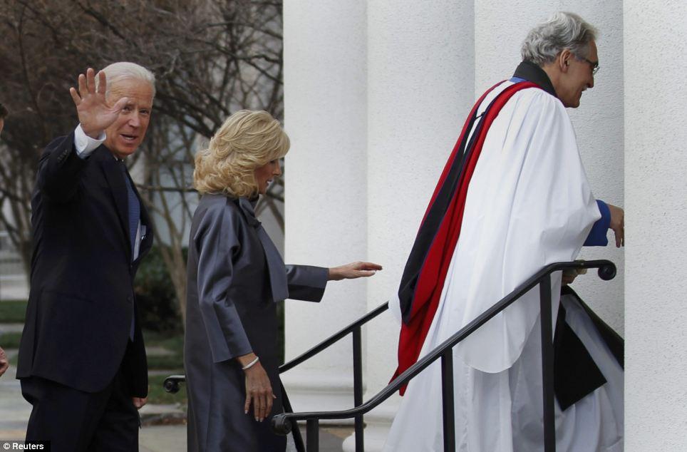 Heading to church: Biden and his wife, Dr. Jill Biden, follow Reverand Luis Leon into St. John's Church