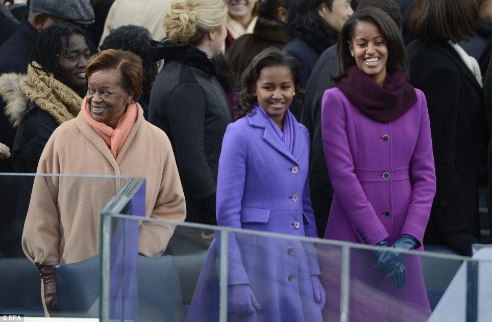 First family: Malia and Sasha Obama arrive at the Capitol building followed closely by their maternal grandmother