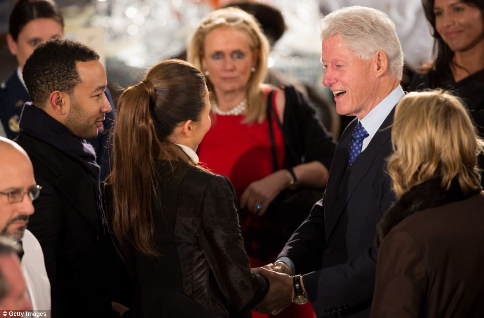 Friendly: Bill Clinton greets singer John Legend and his fiance Christine Teigen at the Inaugural Luncheon in Statuary Hall