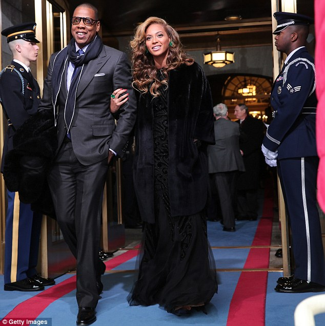 Power couple: Jay-Z and Beyonce arrive at the presidential inauguration on the West Front of the U.S. Capitol in Washington, DC, on Monday