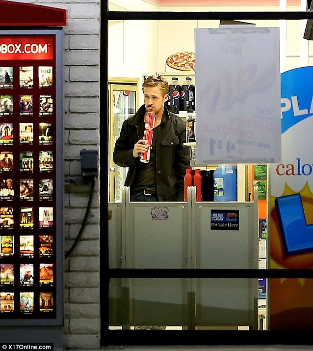 Still handsome: Even late at night, stocking up at the Seven Eleven, Ryan Golsing looks liuke the heartthrob he is