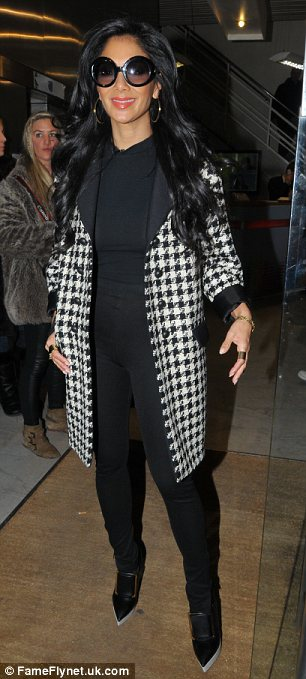 Monochrome on the menu: Nicole wore a houndstooth jacket and a pair of Stella McCartney heels with her skin-tight ensemble