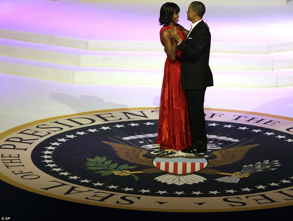 Let's stay together: President Obama and First Lady Michelle celebrate at his second inauguration ball at the Washington Convention Center on Monday night as Jennifer Hudson sang an Al Green classic