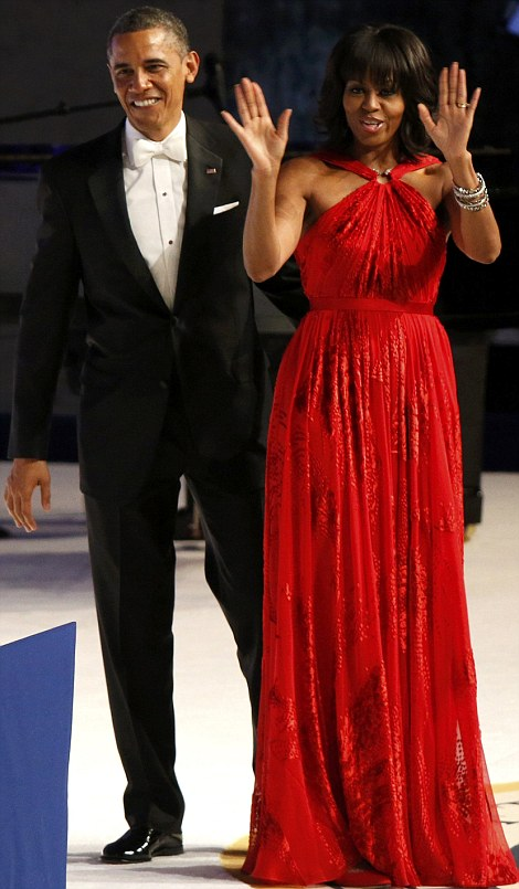 Glamor: President Obama paid a glowing tribute to First Lady Michelle on Monday evening as she wowed in a striking red dress by designer Jason Wu