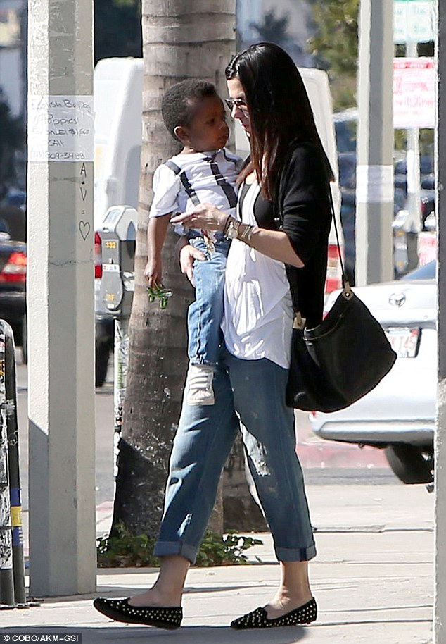 Haircut canceled: Sandra and Louis popped into Rudy's Barbershop, but after taking a walk through were seen leaving without getting a service