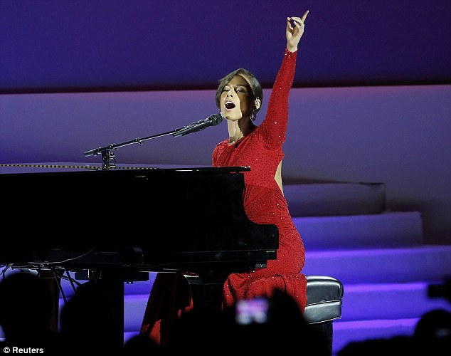 Hitting the high notes: Alicia had the audience entranced as she belted out the words to the song and hitting the keys on her piano