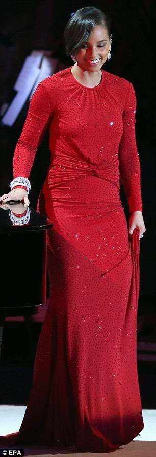 Lady in red: The 31-year-old Fallin' star slipped into a slinky red sequined backless gown for the performance
