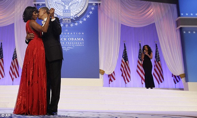 Smitten: The stunning singer sang and watched on as a clearly smitten President Obama and his wife of 20 years kissed as they waltz around onstage