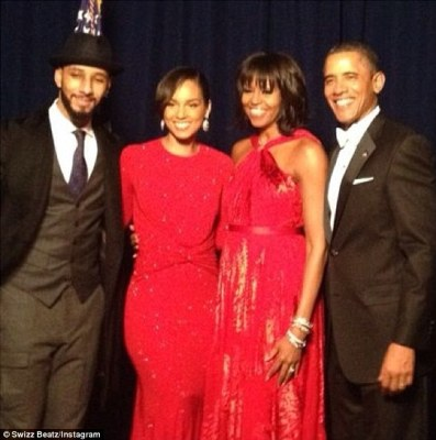 Red hot! Alicia looked stunning in a backless Michael Kors gown as she posed with her husband and the Obama's at Monday's Presidential Inauguration Ball