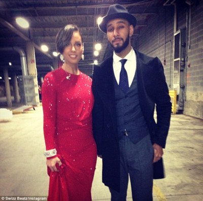 Dapper dude: Meanwhile the 34-year-old hip-hop producer, born Kasseem David Dean, wore a three-piece suit and fedora at the political soiree