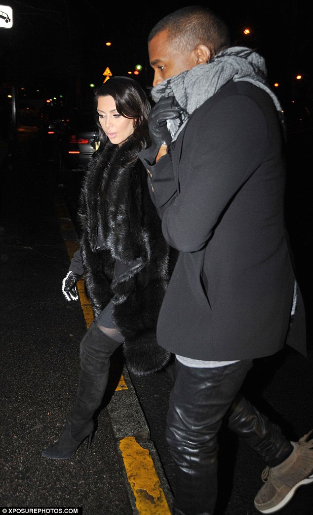 What maternity wear? Kim Kardashian stepped out in daring thigh-high boots and a faux fur coat as she enjoyed a date night with Kanye West on Tuesday