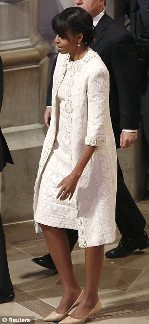 All white: Hours after her inauguration day spectacle, Michelle Obama pulled out one more American designer at the Washington National Cathedral on Tuesday morning: a custom Naeem Khan coat and matching dress