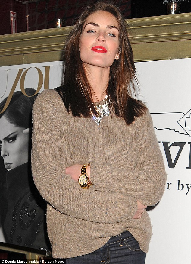 Chin up: Hilary Rhoda managed to look both stylish yet reserved in this wonderful piece of knitwear