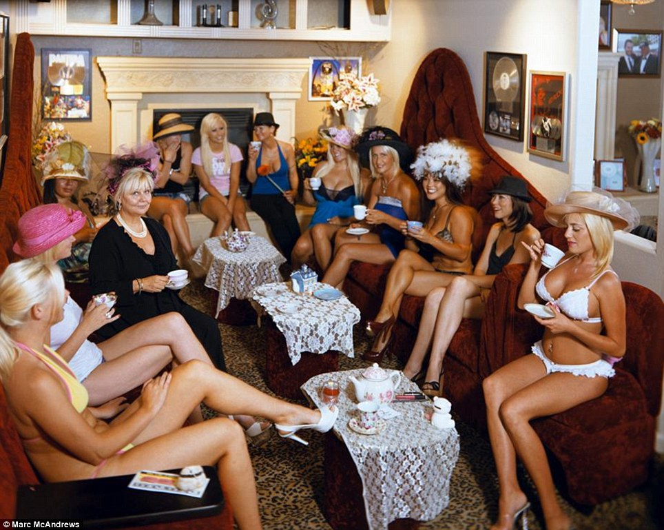 Tea time: The girls of the Bunny Ranch pose for a photo during a 'tea party'