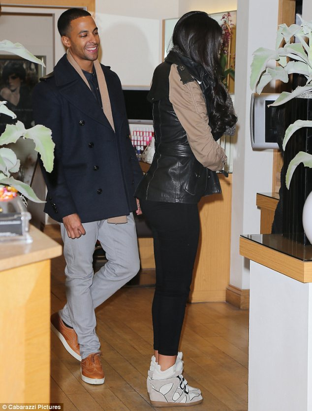 All wrapped up: Rochelle covered her baby bump in a leather jacket with contrasting sleeves