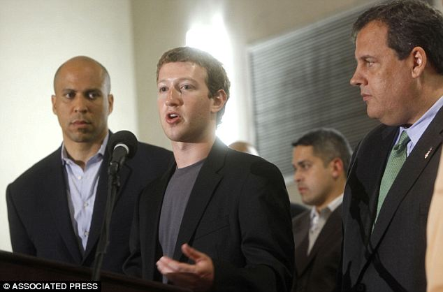 Money talks: Mark Zuckerberg donated $100million to help Newark schools and Governor Chris Christie appeared at a number of events with him- alongside the city's Democratic mayor Cory Booker