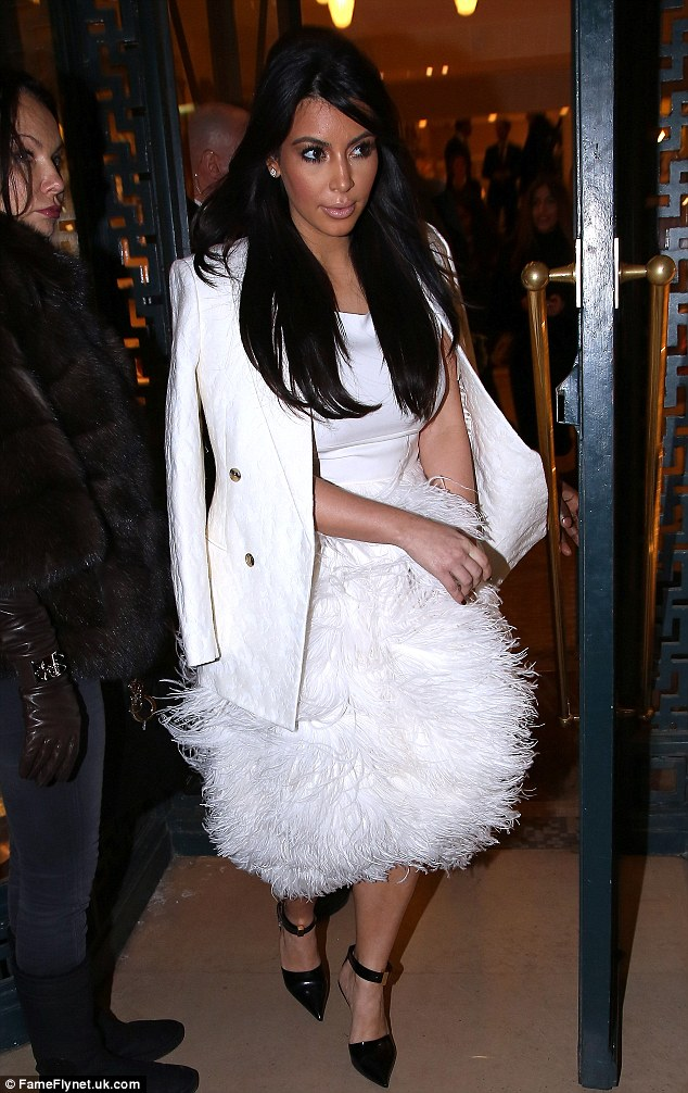 Letting her dress do all the talking: The raven-haired star accessorised with a pair of black stilettos and wore her glossy locks out in her usual straight style