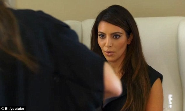 Shocked: Kim looks shocked as Kourtney approaches her whilst unbuttoning her blouse
