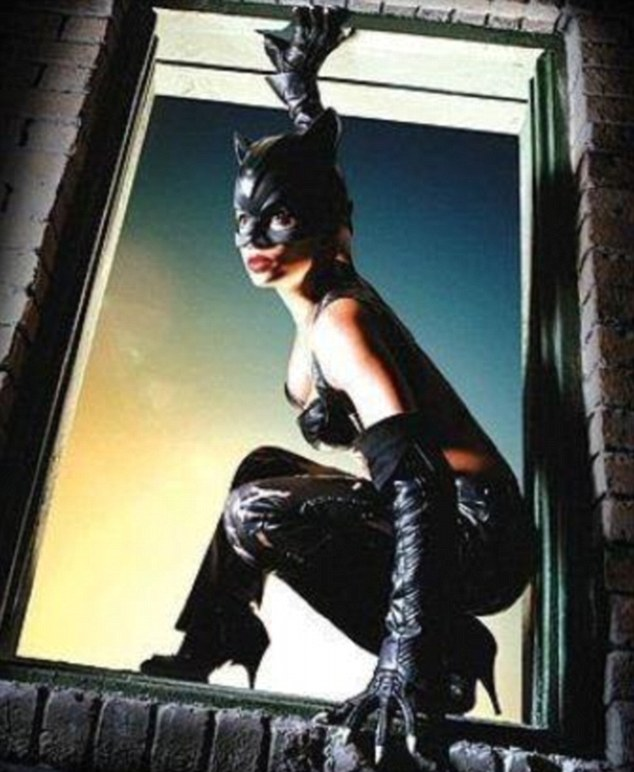 Feline good: The glamorous star clearly loves the look and comfort of leather trousers from her Catwoman era
