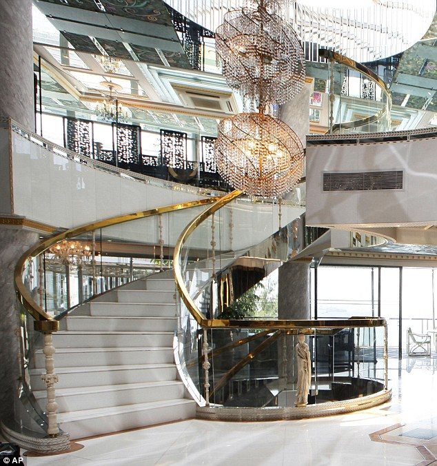 Extravagant: The lavish home which overlooks Sandy Bay features chandeliers and expensive art