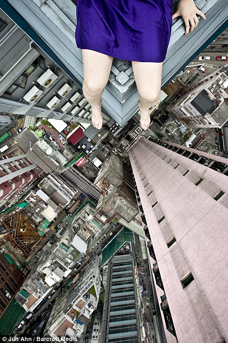 The streets below: Jun Ahn high above the chaotic architecture and bustle of Hong Kong