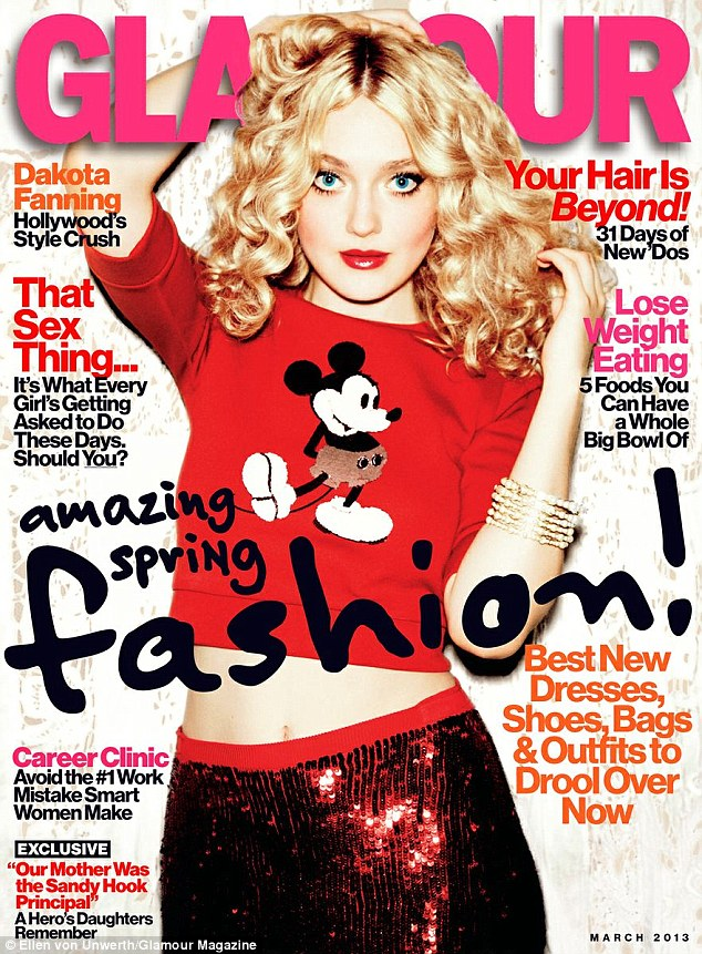 Child starlet: The Twilight Saga starlet proudly dons a Marc Jacobs Mickey Mouse shirt for the mag's March cover, which she pairs with a sequinned Jonathan Saunders skirt and Chanel bracelets