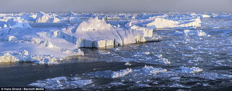 Epic scale: An imposing panorama of an ice-fjord floating along the bone-chilling water in Svalbard