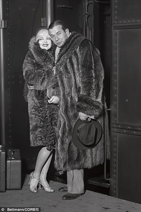 Hollywood stars Clara Bow, pictured left with singer Harry Richman, and Jean Harlow, pictured right, are shown arriving at Grand Central Station in the 1930s