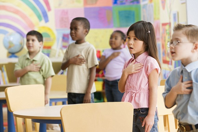 Solemn Duty: Young students recite the Pledge of Allegiance at a school in America