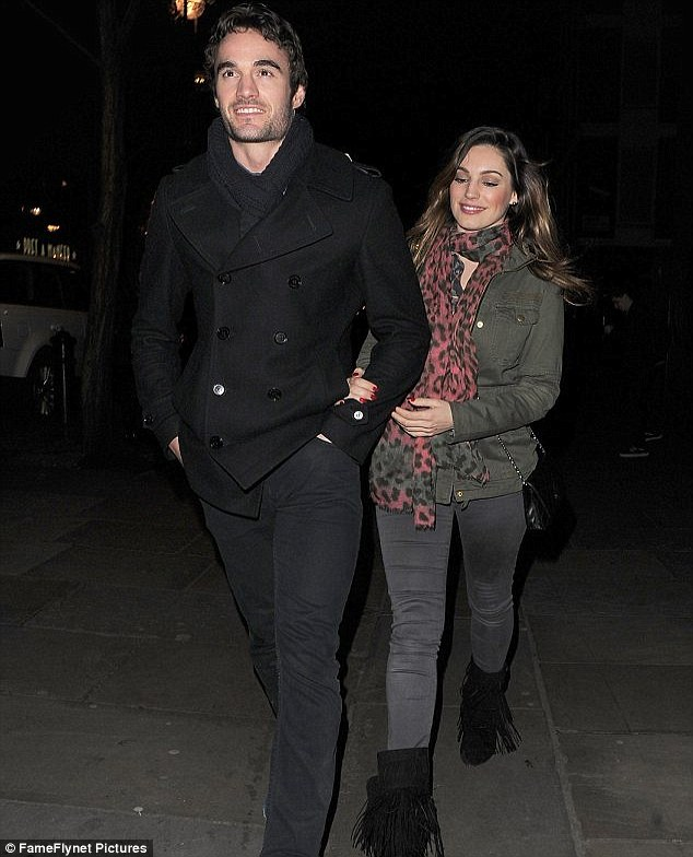 Happier times: One of the last times Kelly and Thom were pictured together, during a night out on 4th January