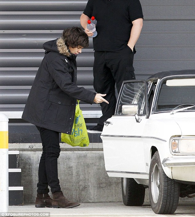 Car lover: It was only a few months ago that Harry was seen eyeing up some vintage cars before buying one