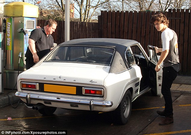 Going for a spin: He dressed comfortably as he took the wheel in a Queen top and skinny jeans