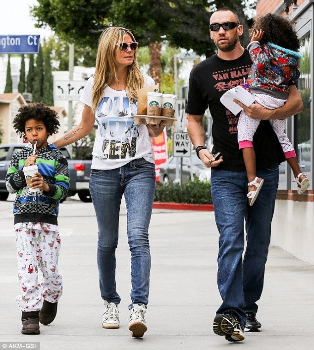 Daddy figure: Martin held Lou and Heidi minded the coffees and her son during a family java run in Brentwood earlier in the day