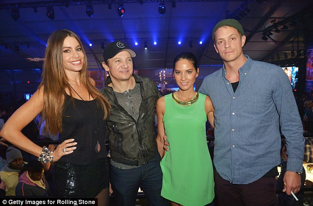 Significant others: Olivia brought her boyfriend Joel Kinnaman, right, and Sofia was joined by her fiance Nick Loeb, but otherwise posed with Renner