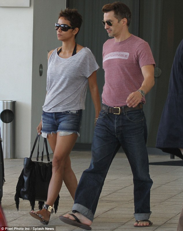Flip-flop stars: Halle Barry and Olivier Martinez were enjoying a second day in Miami, Florida on Sunday