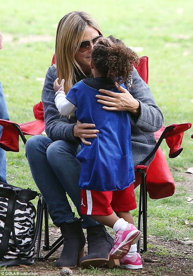 So proud: Heidi is clearly very proud of her youngest child, who looked so cute in her jersey and track shorts