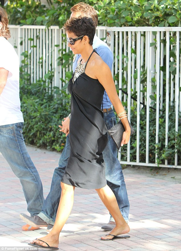 Simple and chic: The actress looked flawless even in a simple black day dress