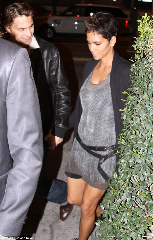 Keeping it cool: The actress wore a loose-fitting grey dress with a belt looped loosely around her waist