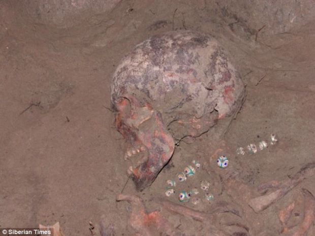 Rare find: The necklace was discovered around the neck of a skeleton in a 24,000-year-old burial mound