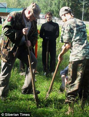 Unusual: Professor Borodovsky, pictured left, said the skeleton was also found with a bronze mirror