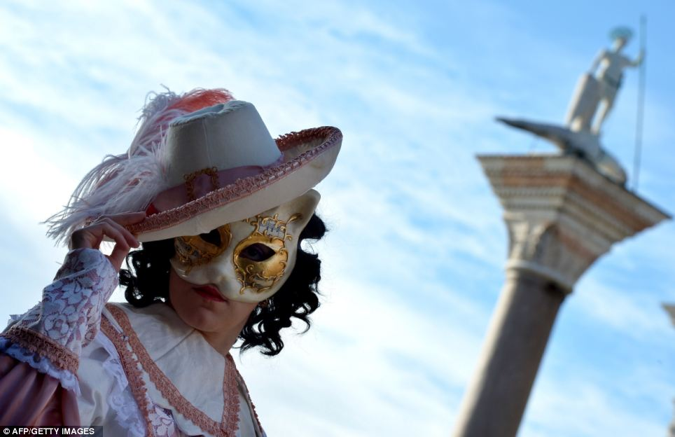 Party reveller: A Venetian poses in extravagant costume for the festival which made a come back in 1979 after almost a hundred years